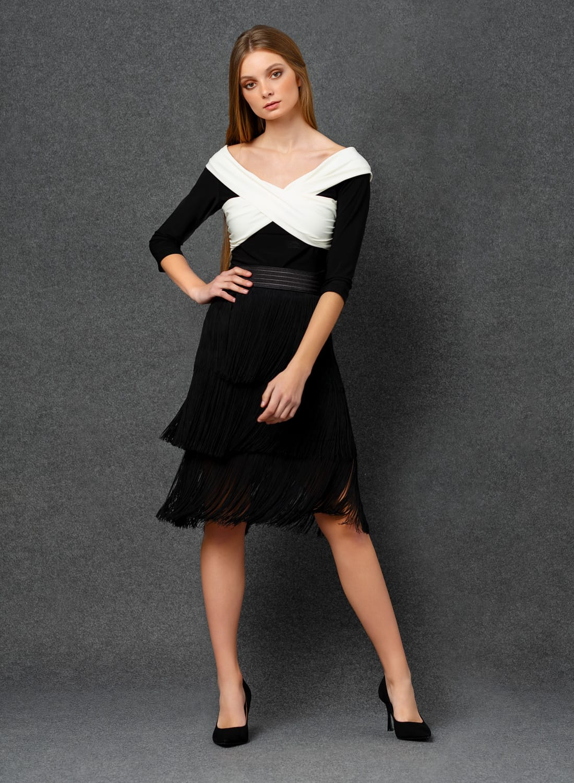top y falda negro con flecos
