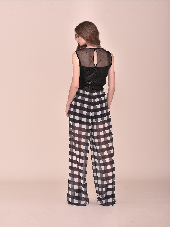 Conjunto fiesta pantalones semitransparente con top negro con flores 2020