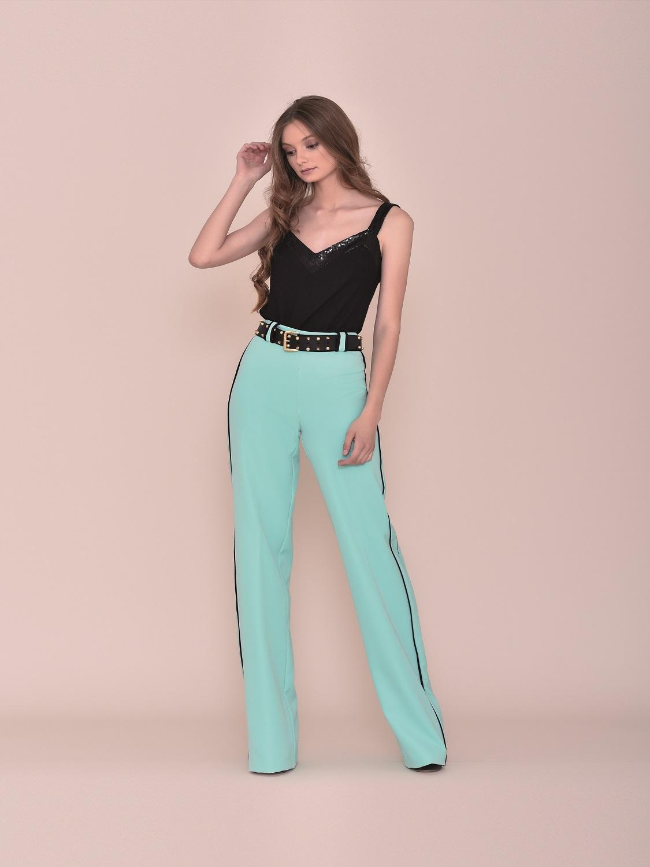 Conjunto pantalón fiesta turquesa con top y detalles negros verano